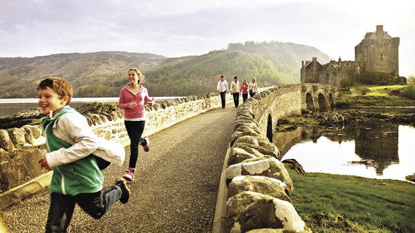 Adventures-by-Disney-guests-visit-Eilean-Donan-Castle.